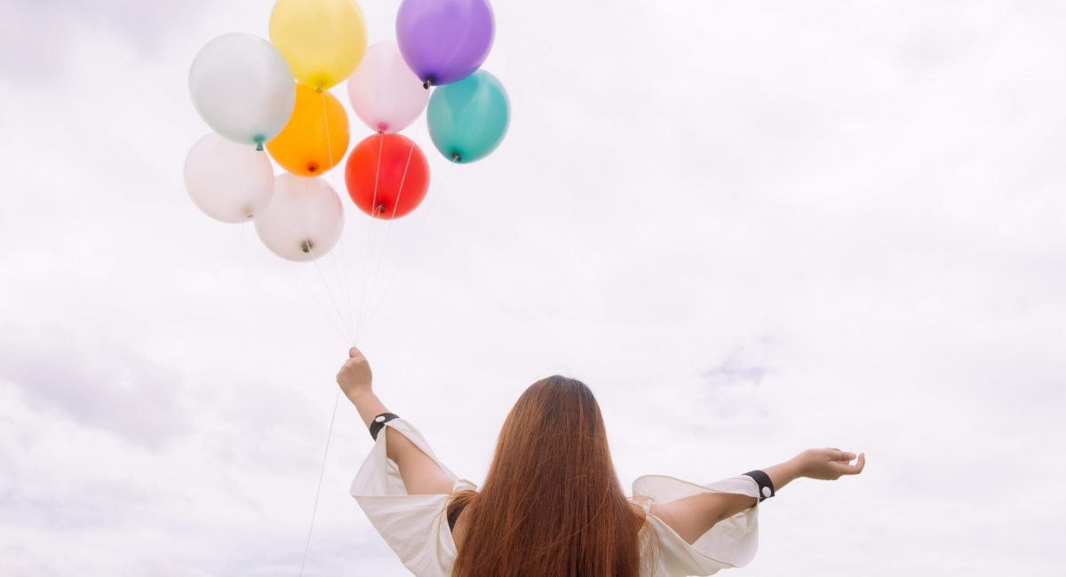 worm-s-eye-view-of-woman-holding-balloons-887824